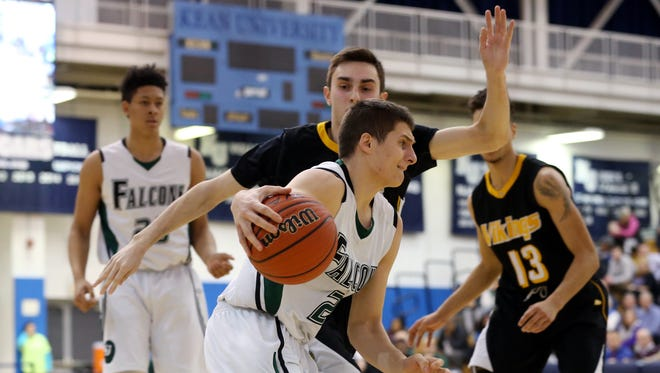 St. Joseph's Branislav Vujadinovic drives past Eric Savage of South Brunswick during the first quarter of the GMC Tournament final on Feb. 25, 2016, at Kean University.