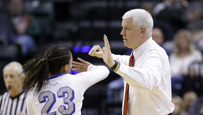 Heritage Christian coach Rick Risinger high-fives  DaShawna Harper (23) during a timeout in the first half of their 3A IHSAA Girls Basketball State Finals Feb 27, 2016 at Bankers Life Fieldhouse.