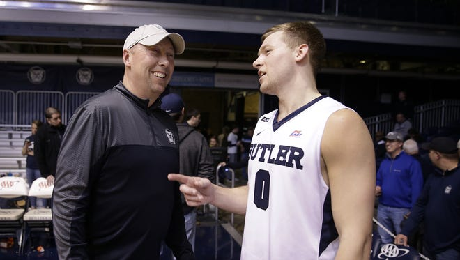 Butler Bulldogs forward Austin Etherington (0),right, talks with his father,  Brett, a former Butler player, following their game Wednesday, Mar 2, 2016, evening at Hinkle Fieldhouse in Indianapolis. The Butler Bulldogs defeated the Seton Hall Pirates 85-78.