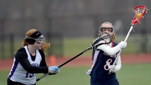 New Oxford's Braxtin Reddinger tries to get past Northern High School's Nicole Jaquette during the lacrosse Play Day at Central York High School on Saturday.