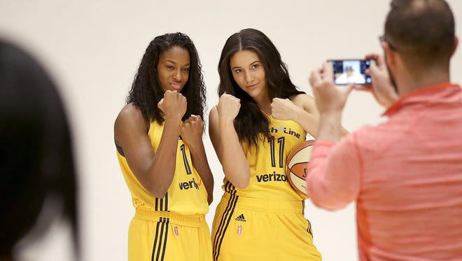 Indiana Fever forward Devereaux Peters (left) posed with teammate   Natalie Achonwa   during the team's media day Monday morning, May 9, 2016,   at Bankers Life Fieldhouse.