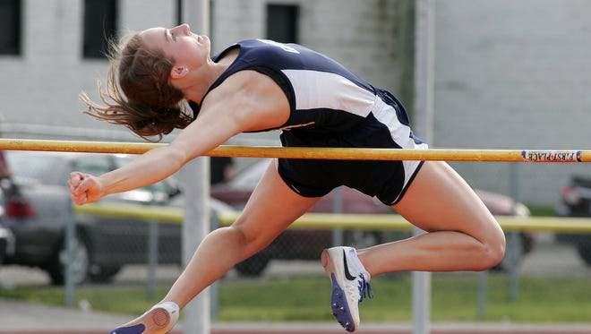 Granville junior Rachael Shomaker competes in the high jump May 12 during the Licking County League-Buckeye Division meet. Shomaker later won the 100 hurdles.