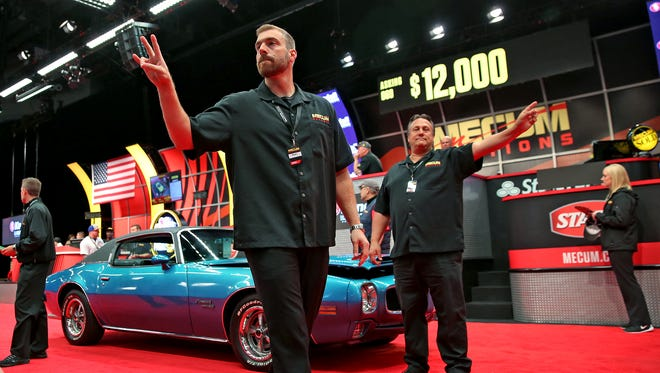 Bids are taken during an auction at the Dana Mecum's 29th Original Spring Classic in the Indiana State Fairgrounds, Tuesday, May 17, 2016.  The show goes through May 22, 2016.