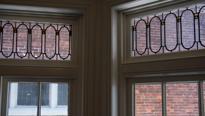 The stained glass, seen left above the windows in the Goodridge House, was recently matched by glass, seen in the upper right, created by Ehrhart Stained Glass, as part of the renovations of the historic home and underground railroad museum in time for the tour that ran Saturday.
