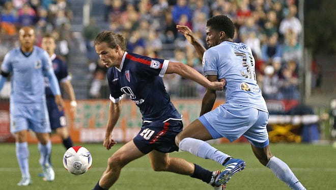 Indy Eleven forward Justin Braun (20) pushes past Minnesota United FC defender Damion Lowe (31) in the second half of the Indy Eleven's game against Minnesota United FC at IUPUI's Carroll Stadium, Indianapolis, Saturday, May 21, 2016.