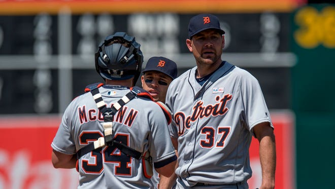 May 29, 2016; Oakland, CA, USA; Detroit Tigers starting pitcher Mike Pelfrey and catcher James McCann wait for a visit to the mound by Tigers pitching coach Rich Dubee during the sixth inning against the Oakland Athletics at Oakland Coliseum.