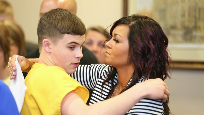 Kristi Blevins hugs her son, James 'Austin' Hancock, 15, after his sentencing for the shooting at Madison High School in Madison Township February 29.
