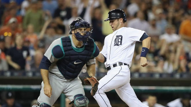 Detroit Tigers baserunner Andrew Romine scores the winning run on a Mike Aviles single against the Seattle Mariners on Tuesday, June 21, 2016, at Comerica Park in Detroit.