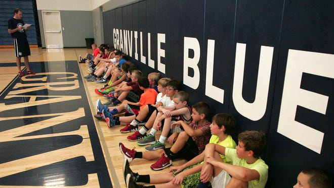 Granville youth boys basketball camp participants get broken up into teams Monday morning for 3-on-3 games.