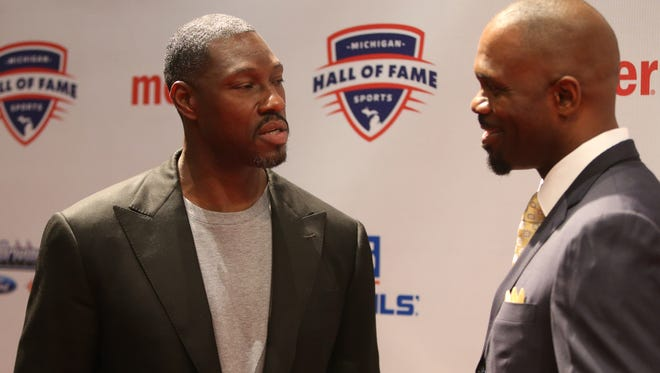 Former Detroit Piston Ben Wallace, left, and Grant Long talk on the Red Carpet before the Michigan Sports Hall of Fame ceremony Friday, Sept. 9, 2016 at the Max M. Fisher Music Center in Detroit.