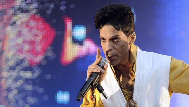 Prince performs in 2011 on stage at the Stade de France in Saint-Denis, outside Paris.