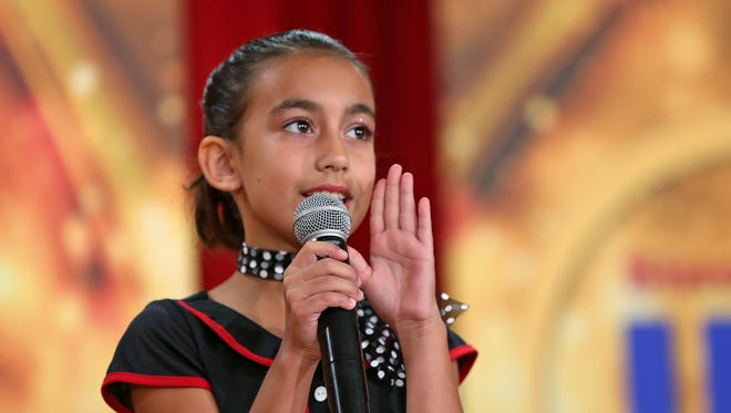 """Josie Campbell sings """"Rock Around the Christmas Tree,"""" during auditions on Saturday, Oct. 1, 2016, for the 54th Annual Circle of Lights ceremony that will take place Nov. 25 on Monument Circle."""