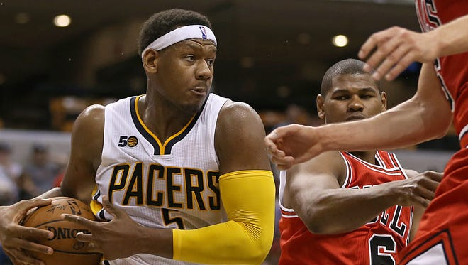 Indiana Pacers forward Lavoy Allen (5) rebounds under the Bulls' basket during second half action against the Chicago Bulls, Banker's Life Fieldhouse, Indianapolis, Thursday, October 6, 2016. The Pacers won, 115-108.