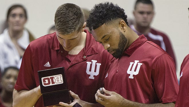 Indiana Hoosiers forward Collin Hartman (30) and Indiana Hoosiers guard James Blackmon Jr. (1) look at their 2015-2016 championship rings after the team received them by surprise during Hoosier Hysteria at Assembly Hall, Bloomington, Ind., Saturday, October 22, 2016.