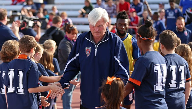 Indy Eleven head coach Tim Hankinson takes the field before playoff semifinals between Indy Eleven and FC Edmonton, at IUPUI's Michael A. Carroll Stadium, Indianapolis, Saturday, November 5, 2016.