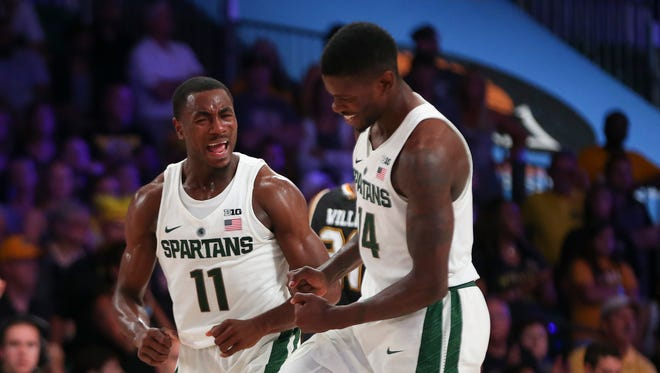 Michigan State guard Tum Tum Nairn Jr. (11) celebrates with guard Eron Harris during the first half against Wichita State on Friday, Nov. 25, 2016, in the Bahamas.