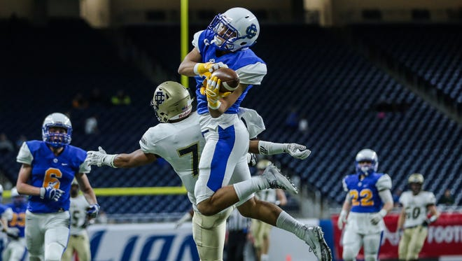 Grand Rapids Catholic Central's Anthony Shukis intercept the ball from Birmingham Detroit Country Day's Roy McCree IV during GRCC's 10-7 win in the Division 4 state title game Friday at Ford Field.