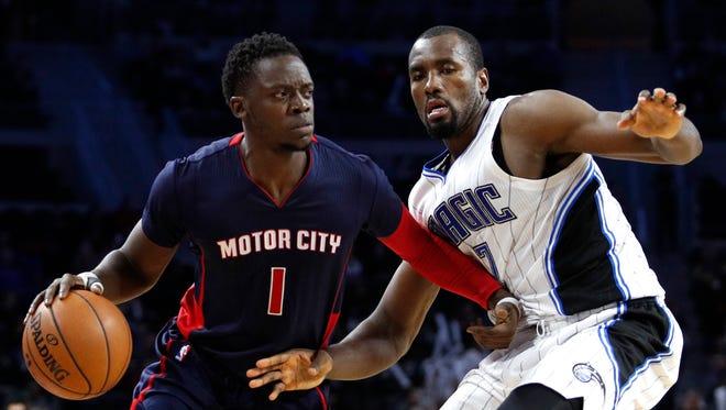 Dec 4, 2016; Auburn Hills, MI, USA; Pistons guard Reggie Jackson is defended by Orlando Magic forward Serge Ibaka during the third quarter at the Palace.