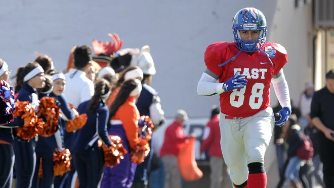 Americas defensive end Mike Munoz is the El Paso Times' All City defensive player of the year.