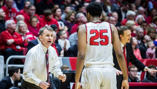 Ball State head coach James Whitford talks to Tahjai Teague during a game against Western Michigan at Worthen Arena Saturday, Jan. 28, 2017.