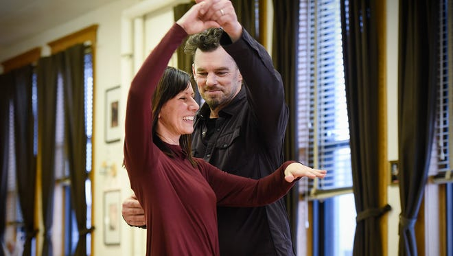 Jeff Yapuncich spins his wife Rochelle during their dance rehearsal Wednesday, Feb. 8, at StudioJeff in St. Cloud.