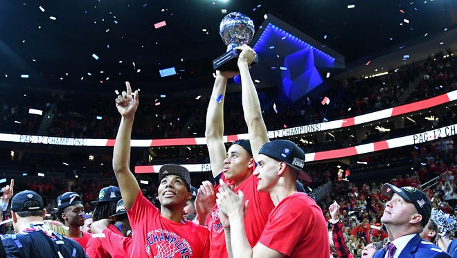Mar 11, 2017: Arizona Wildcats players celebrate with the Pac-12 Championship trophy after the Wildcats defeated the Oregon Ducks 83-80 in the Pac-12 Conference Championship game at T-Mobile Arena.