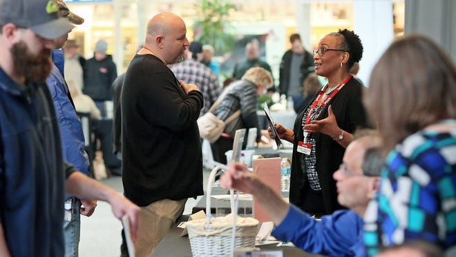 Jonna Singleton, right, of TJMaxx, speaks with Shawn Paxton of Hebron Wednesday during the Ohio Means Jobs/Licking County Job Fair at Indian Mound Mall.