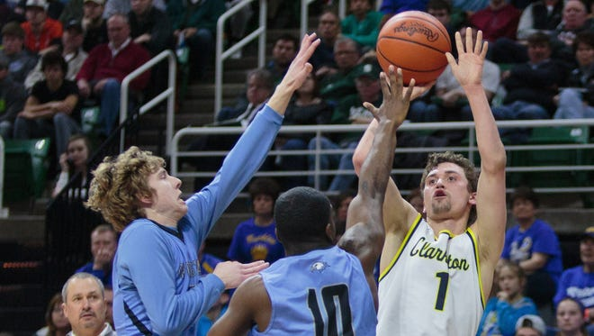 Clarkston's Foster Loyer shoots against Grand Rapids Christian during the Class A championship on March 25, 2017.