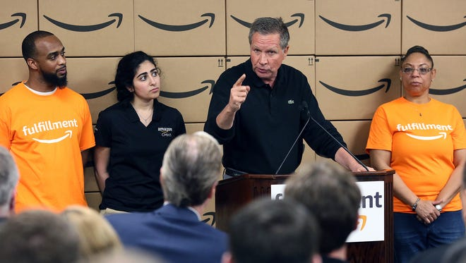 Ohio Governor John Kasich addresses a small crowd Monday afternoon at Amazon's Etna fulfillment center. Kasich was given a tour of the facility that employs about 3,000 people who work alongside robots to fulfill Amazon orders.