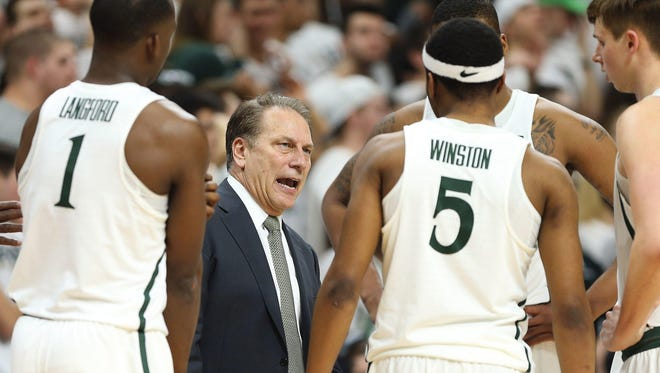 Feb 26, 2017; East Lansing, MI, USA; Michigan State Spartans head coach Tom Izzo talks to players during the second half against the Wisconsin Badgers at the Jack Breslin Student Events Center.