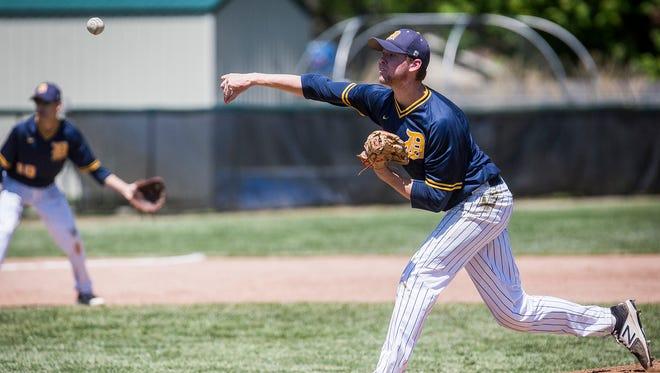 Delta's Adam Haynes pitches against Yorktown during their game at Yorktown High School Saturday, May 13, 2017.
