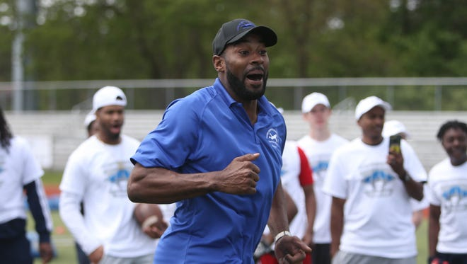 Former Detroit Lions receiver Calvin Johnson encourages young players during the Calvin Johnson Jr. Foundation Catch a Dream football camp held at Southfield high school Saturday, May 20, 2017 in Southfield.