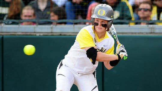Oregon third baseman Jenna Lilley watches a pitch go