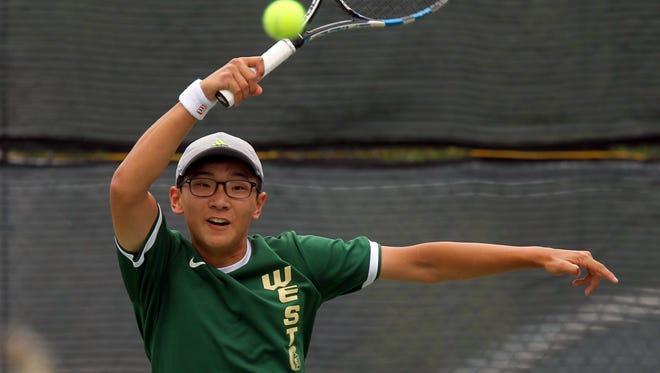 West High's Jiung Jung returns a shot during this 2A singles match against Pleasant Valley's Sriram Sugumaran at Veterans Memorial Tennis Center in Cedar Rapids on Friday, May 26, 2017.