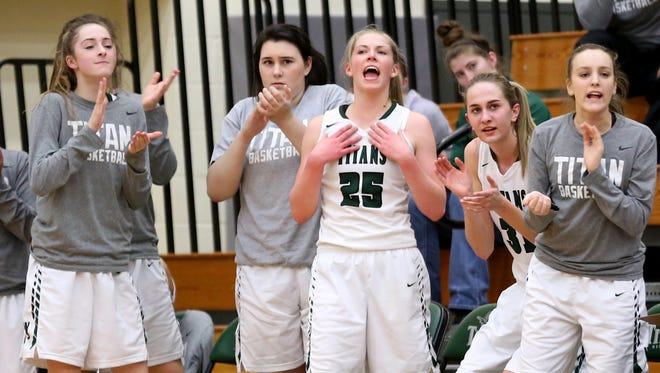 The West Salem bench celebrates a play during the first half of the Central Catholic vs. West Salem girl's basketball game, in the first round of the OSAA State Championships playoffs, at West Salem High School on Wednesday, March 1, 2017. West Salem won the gam 53-46. They will play South Salem in Round 2 of the OSAA State Championships playoffs on March 4.