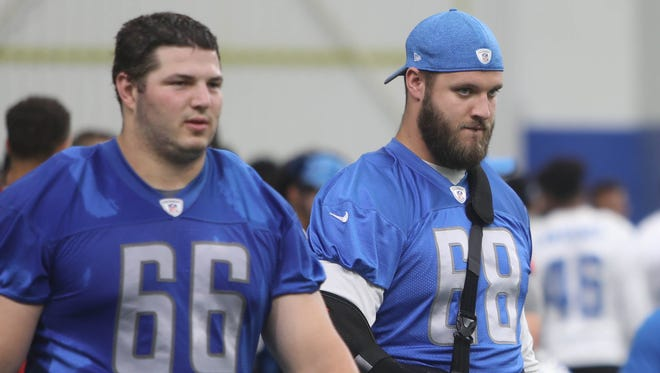Detroit Lions linemen Joe Dahl, left, and Taylor Decker walk off the field after minicamp Thursday, June 15, 2017 at the practice facility in Allen Park.