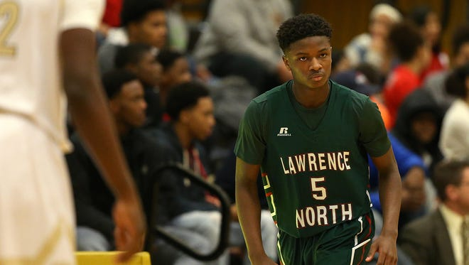 Lawrence North Wildcat sophomore Jared Hankins (5) goes into the game at Marion County boys quarterfinals between Warren Central and Lawrence North, at Warren Central High School, Indianapolis, Wednesday, Jan. 11, 2016.