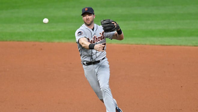 Tigers shortstop Andrew Romine (17) throws to first base in the second inning of the Tigers' 2-0 loss to the Indians on Tuesday, Sept. 12, 2017, in Cleveland.