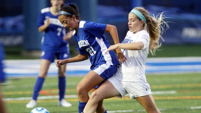 Metuchen's Mya Stolarski battles for possession with Shore Regional's Frankie McDonough during Central Group I girls soccer sectional final, Thursday, November 12, 2015, in West Long Branch.