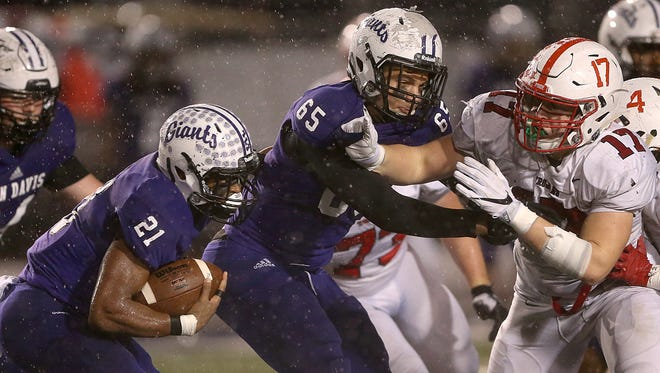 Ben Davis tackle Skylar Fletcher (65) has helped clear the way for a loaded Giants offense.