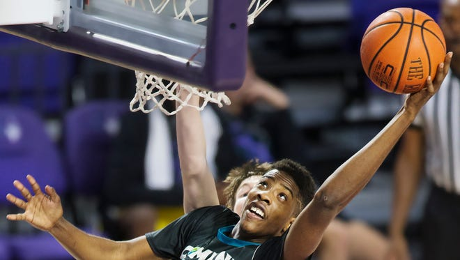 Combine Academy's Amari Haynes rebounds against the State College of Florida on Saturday during the Florida SouthWestern State College basketball classic at Suncoast Credit Union Arena in south Fort Myers. Haynes is a Mariner High School graduate.