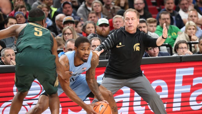 Michigan State coach Tom Izzo directs as his team plays defense against the North Carolina in the first half in the Phil Knight Invitational tournament in Portland, Ore., Sunday, Nov. 26, 2017.