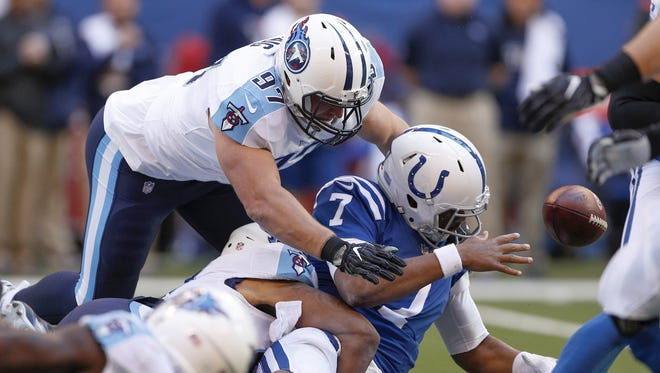 Indianapolis Colts quarterback Jacoby Brissett (7) is sacked by Tennessee Titans defensive end Karl Klug (97) and Derrick Morgan (91) in the first half of their game at Lucas Oil Stadium Sunday, Nov. 26, 2017.