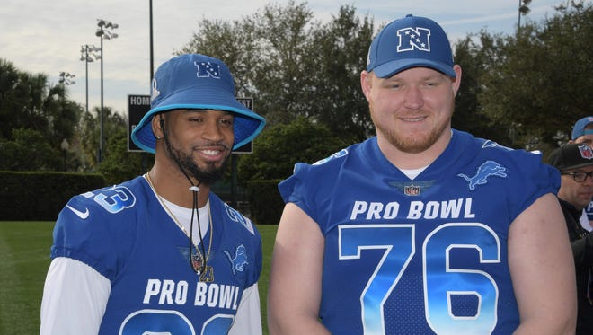 Lions cornerback Darius Slay, left, and guard T.J. Lang pose during NFC practice for the Pro Bowl at ESPN Wide World of Sports on Jan. 25, 2018.