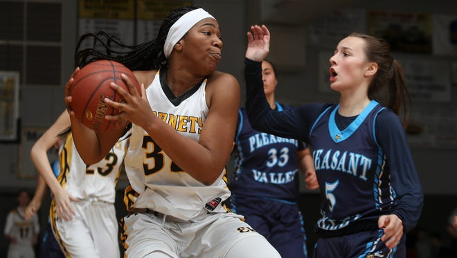 Enterprise's Justyse Cooper looks to get the ball past Pleasant Valley's Chloe Mayer in Thursday's 62-55 Hornet loss.
