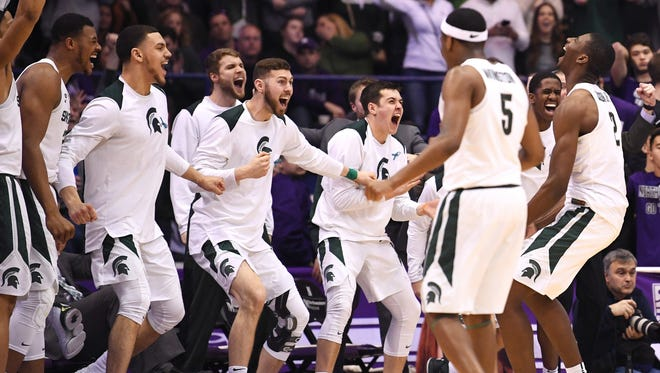 Michigan State forward Jaren Jackson Jr. (far right) celebrates with his team during the second half of MSU's 65-60 win on Saturday in Rosemont, Ill.