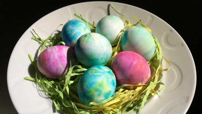Eggs for Easter that have been dyed with using tinted whipped cream that can be rinsed off.