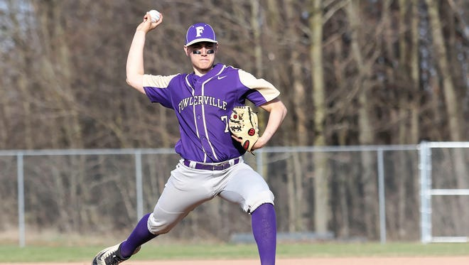 Fowlerville's Sam Browne threw a four-inning perfect game in a 15-0 victory over St. Johns on Thursday, April 26, 2018.
