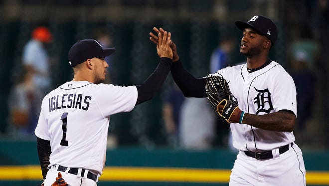 Tigers shortstop Jose Iglesias, left, and right fielder Niko Goodrum celebrate after defeating the Indians, 6-3, at Comerica Park on Monday.