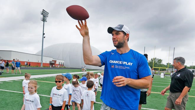 Indianapolis Colts quarterback Andrew Luck throws passes as he runs football drills with kids during the Change the Play camp at UIndy, Wednesday, June 27, 2018.